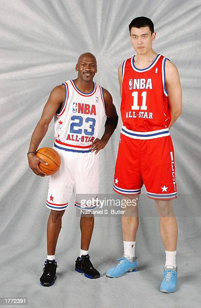 Michael Jordan and Yao Ming pose for a portrait prior to the 2003 NBA AllStar game during the 2003 NBA AllStar weekend at the Philips Arena on...