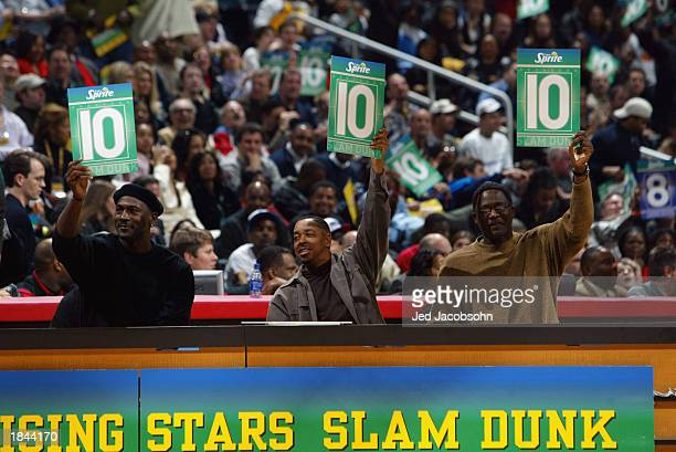 Michael Jordan Anthony 'Spud' Webb and Dominique Wilkins judge the Sprite Rising Stars Slam Dunk Contest during the 2003 NBA AllStar Weekend at...