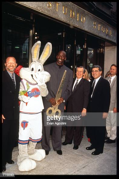 Michael Jordan Bugs Bunny and Warner Bros executives stand in front of the Warner Bros Studio store October 23 1996 in New York City The store...
