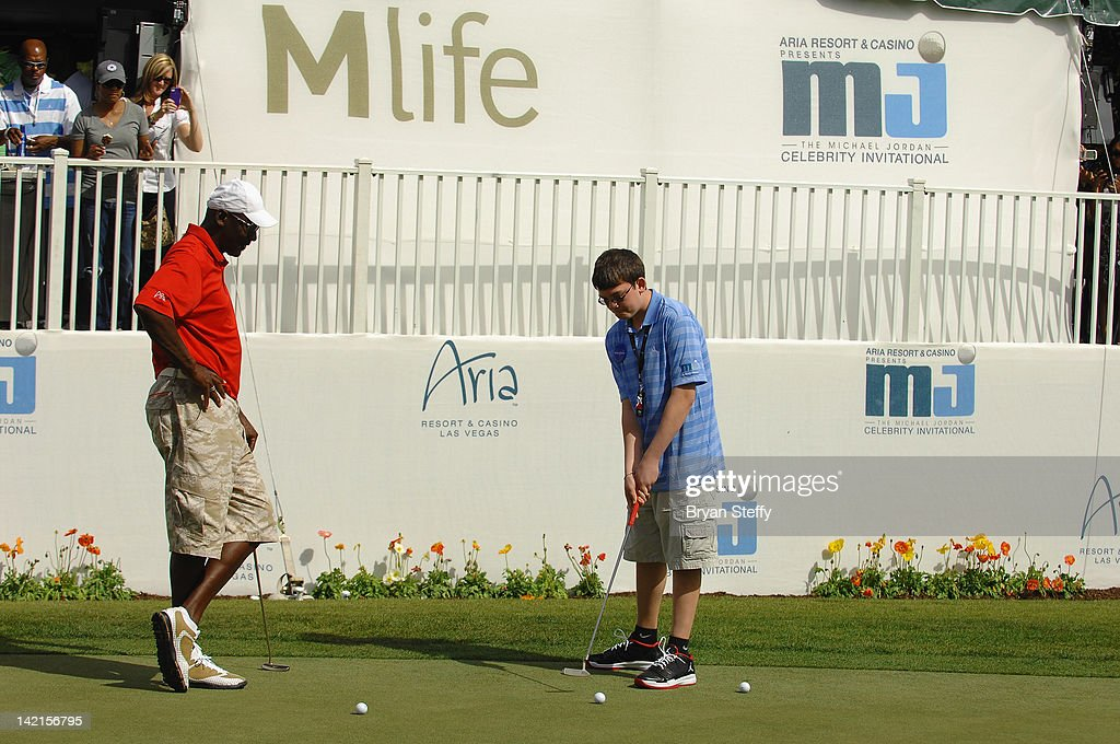 <a gi-track='captionPersonalityLinkClicked' href=/galleries/search?phrase=Michael+Jordan&family=editorial&specificpeople=73625 ng-click='$event.stopPropagation()'>Michael Jordan</a> fulfills a wish for Make-A-Wish child Lucas Stroud at the 11th Annual <a gi-track='captionPersonalityLinkClicked' href=/galleries/search?phrase=Michael+Jordan&family=editorial&specificpeople=73625 ng-click='$event.stopPropagation()'>Michael Jordan</a> Celebrity Invitational hosted by Aria Resort & Casino at Shadow Creek on March 30, 2012 in Las Vegas, Nevada.