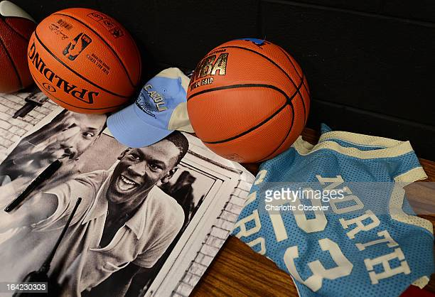 Michael Jordan items sit on a table backstage at Vance High School on Thursday March 21 2013 Bobcats Sports and Entertainment along with FOX Sports...