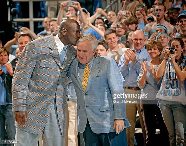 Michael Jordan kisses former coach Dean Smith of the North Carolina Tar Heels during a halftime ceremony honoring the 1993 national championship team...