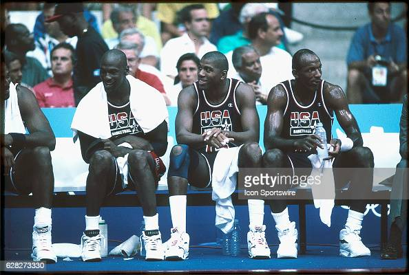 Michael Jordan Magic Johnson and Clyde Drexler of Team USA the Dream Team sit on the bench during the men's basketball competition at the 1992 Summer...