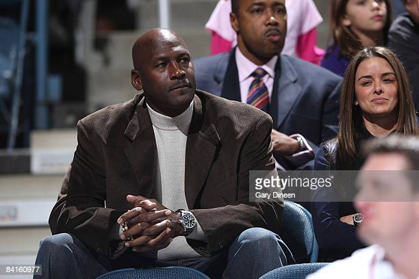 Michael Jordan Managing Member of Basketball Operations of the Charlotte Bobcats watches the NBA game against the Milwaukee Bucks on January 2 2009...