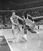 Michael Jordan of North Carolina drives to the basket during first half action 3/22 as Dan Dakich of Indiana attempts to cover him