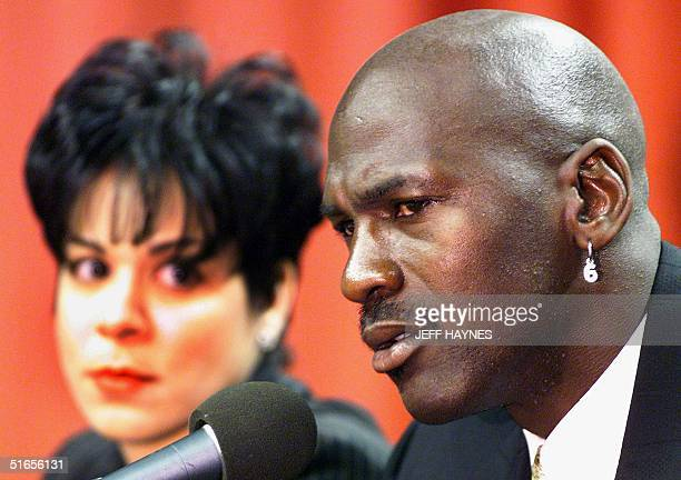 Michael Jordan of the Chicago Bulls accompaned by his wife Juanita announces at a press conference at the United Center 13 January that he is...