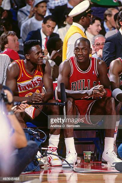 Michael Jordan of the Chicago Bulls and Dominique Wilkins of the Atlanta Hawks talk during the 1988 Slam Dunk Contest as part of AllStar Weekend on...