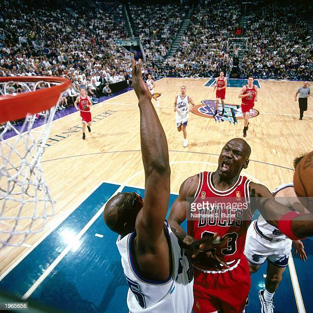 Michael Jordan of the Chicago Bulls attemps a layup against the Utah Jazz during Game five of the 1997 NBA Finals at the Delta Center on June 11 1997...