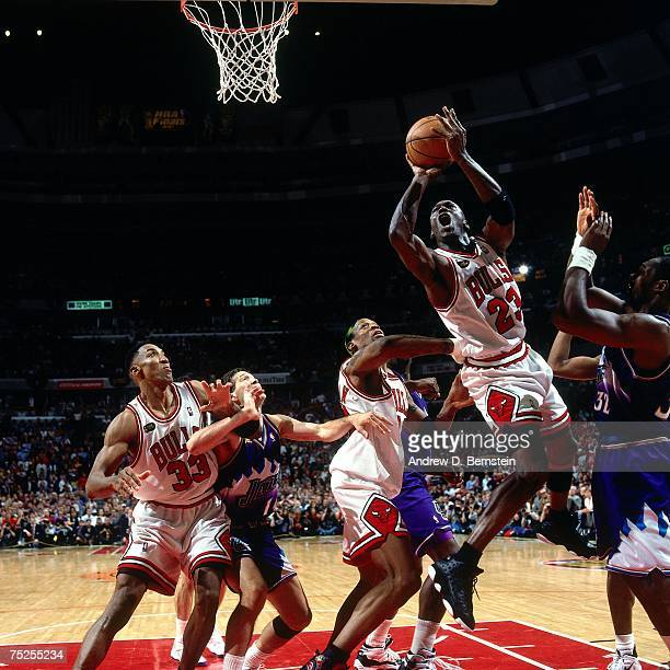 Michael Jordan of the Chicago Bulls attempts a layup against Karl Malone of the Utah Jazz in Game Five of the 1998 NBA Finals at the United Center on...
