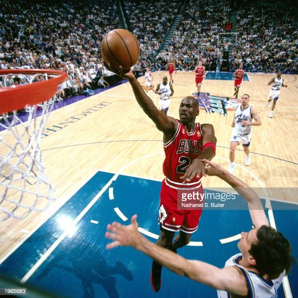 Michael Jordan of the Chicago Bulls attempts a layup against the Utah Jazz during Game five of the 1997 NBA Finals at the Delta Center on June 11...