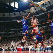 Michael Jordan of the Chicago Bulls attempts a reverse layup against the Orlando Magic in Game four of the Eastern Conference Semifinals during the...