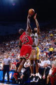 Michael Jordan of the Chicago Bulls blocks the shot attempt of Derrick McKey of the Indiana Pacers in Game Four of the Eastern Conference Finals...