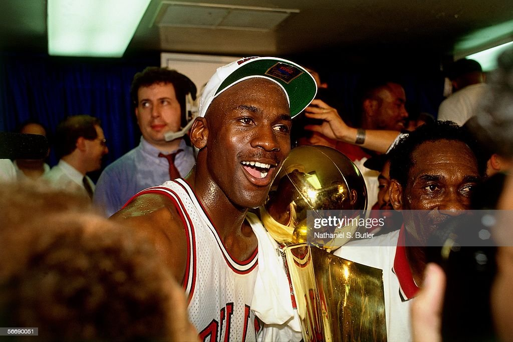Michael Jordan of the Chicago Bulls celebrates after Game 6 of the NBA Finals against the Portland Trail Blazers on June 14 1992 at Chicago Stadium...