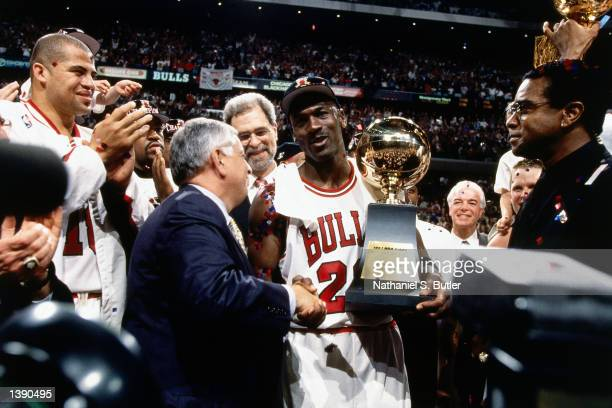 Michael Jordan of the Chicago Bulls celebrates with Bison Dele after winning the 1997 NBA Finals against the Utah Jazz in Chicago IL on June 13 1997...
