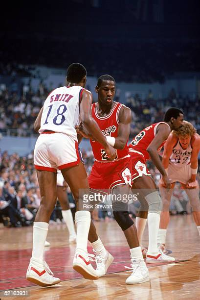 Michael Jordan of the Chicago Bulls defends Derek Smith of the Los Angeles Clippers during a December 1984 season game at the Sports Arena in Los...