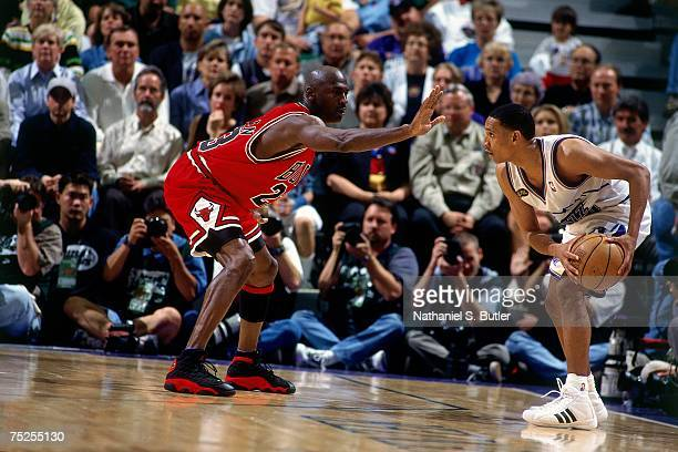 Michael Jordan of the Chicago Bulls digs in on defense against Howard Eisley of the Utah Jazz in Game Two of the 1998 NBA Finals at the Delta Center...