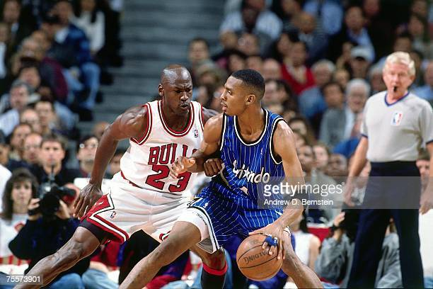 Michael Jordan of the Chicago Bulls digs in on defense against Anfernee Hardaway of the Orlando Magic during Game Six of the 1995 Eastern Conference...