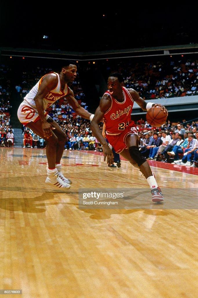 Michael Jordan of the Chicago Bulls dribbles against the Atlanta Hawks during his rookie season of 1984 at the Omni in Atlanta Georgia NOTE TO USER...