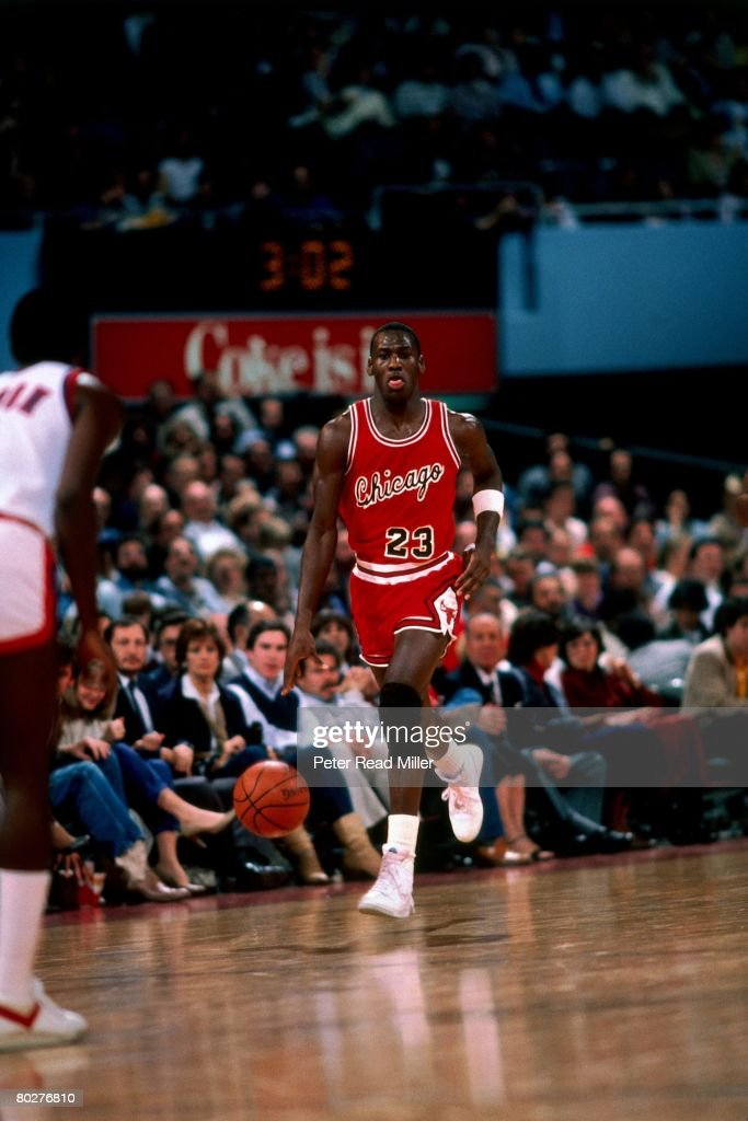 Michael Jordan of the Chicago Bulls dribbles upcourt during his rookie season in 1984 in Chicago Illinois NOTE TO USER User expressly acknowledges...