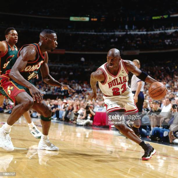 Michael Jordan of the Chicago Bulls drives baseline against Shawn Kemp of the Seattle SuperSonics during Game six of the 1996 NBA Finals at the...