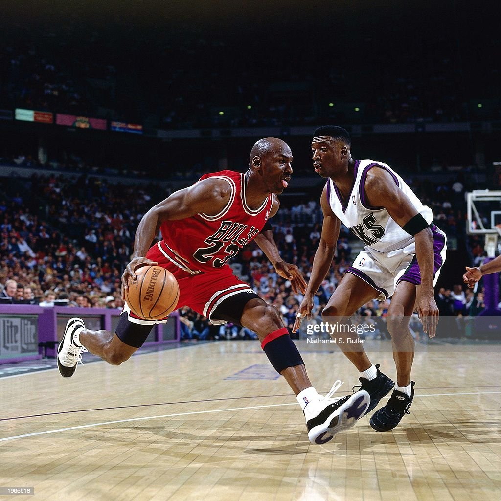 Michael Jordan of the Chicago Bulls drives baseline against the Milwaukee Bucks during the NBA game at the Bradley Center on April 16 1996 in...