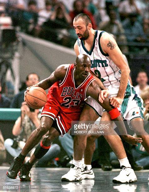Michael Jordan of the Chicago Bulls drives past Vlade Divac of the Charlotte Hornets 08 May during the first quarter of game three of their Eastern...