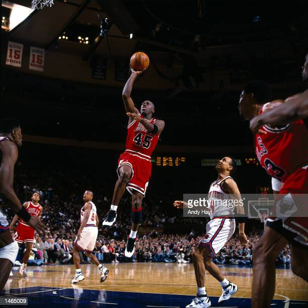 Michael Jordan of the Chicago Bulls drives to the basket against John Starks of the New York Knicks during the NBA game at Madison Square Garden in...