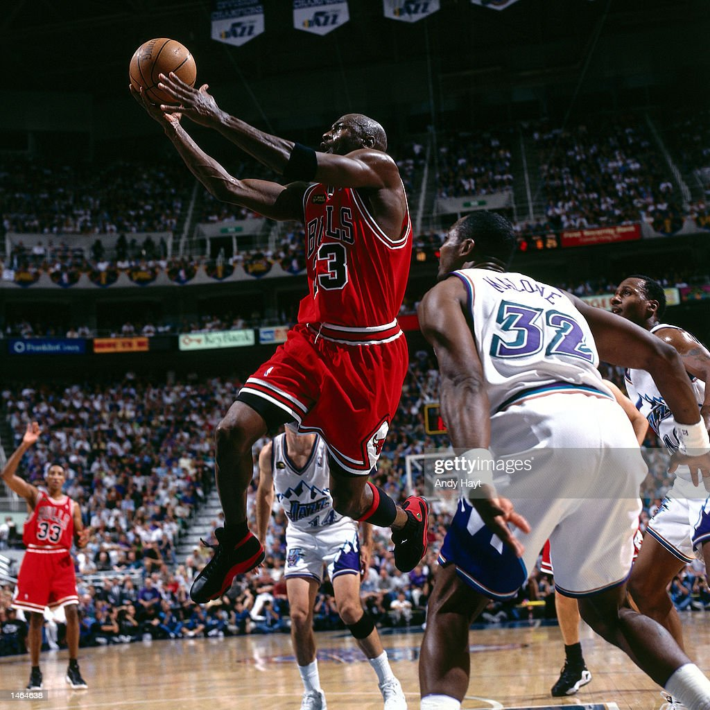 Michael Jordan of the Chicago Bulls drives to the basket against Karl Malone of the Utah Jazz during the 1998 NBA Finals at the Delta Center in Salt...