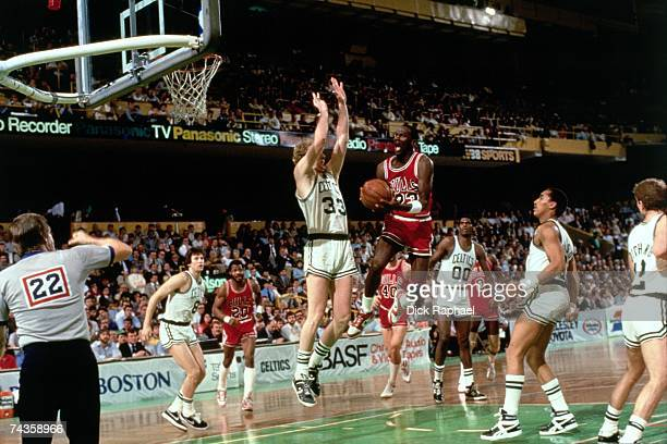 Michael Jordan of the Chicago Bulls drives to the basket against Larry Bird of the Boston Celtics during Game 2 of the Eastern Conference...