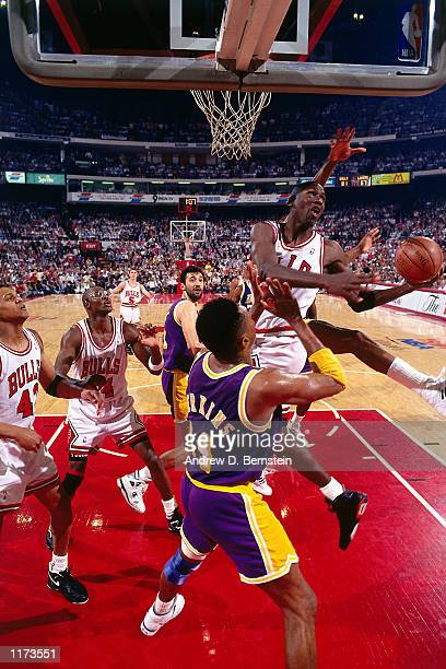 Michael Jordan of the Chicago Bulls drives to the basket against Sam Perkins of the Los Angeles Lakers during game 2 of the 1991 NBA Finals at...