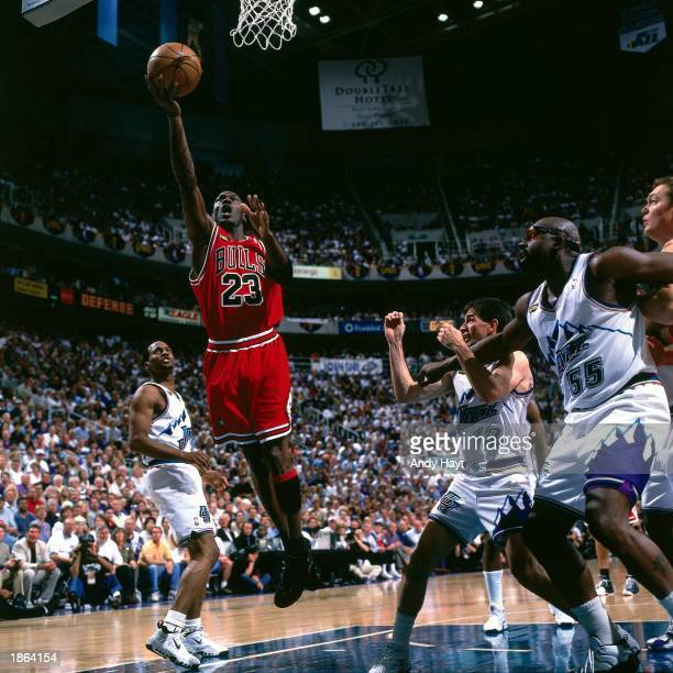 Michael Jordan of the Chicago Bulls drives to the basket against the Utah Jazz during Game Six of the 1998 NBA Championship Finals in Salt Lake City...