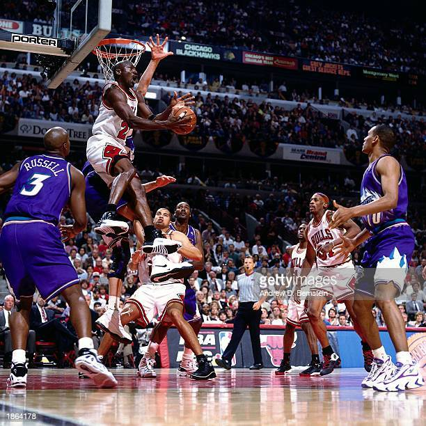 Michael Jordan of the Chicago Bulls drives to the basket against the Utah Jazz during Game Six of the 1997 NBA Championship Finals at the United...