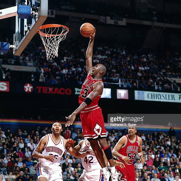 Michael Jordan of the Chicago Bulls drives to the basket against the Philadelphia 76ers during the NBA game at the First Union Spectrum on March 18...