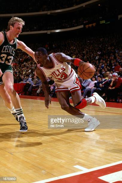 Michael Jordan of the Chicago Bulls drives to the basket during the 1980 NBA game against the Boston Celtics at Chicago Stadium in Chicago Illinois...
