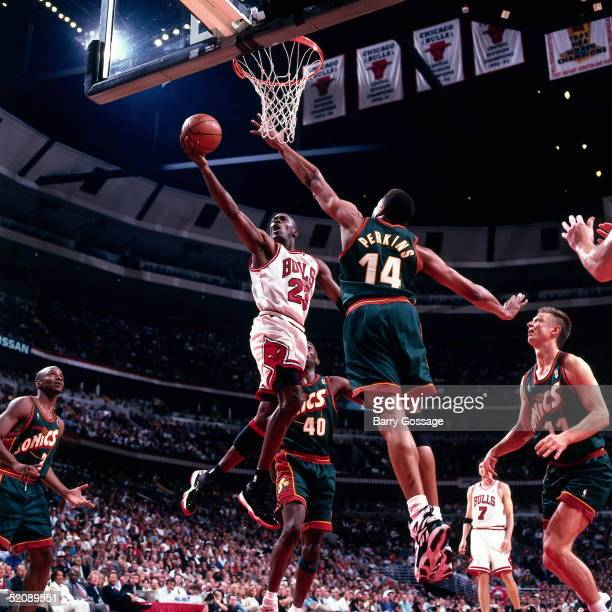 Michael Jordan of the Chicago Bulls drives to the basket for a layup against the Seattle Sonics during Game two of the 1996 NBA Finals at United...