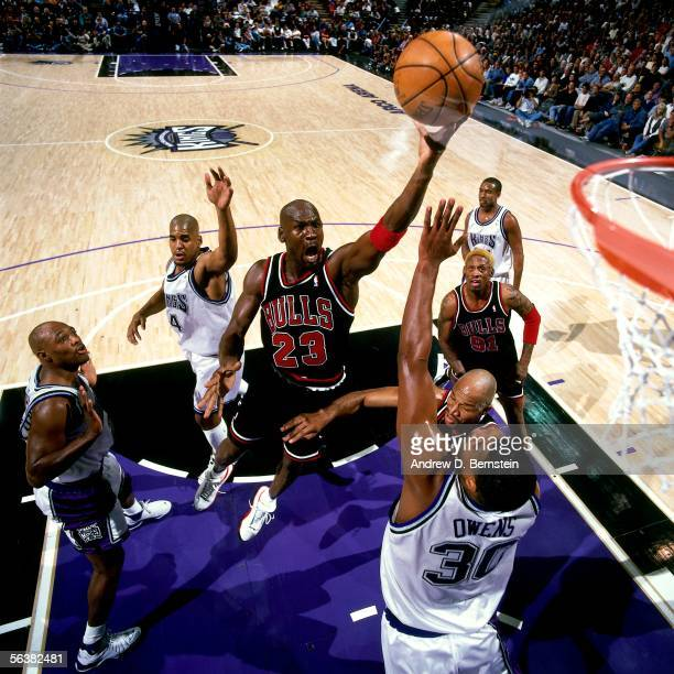 Michael Jordan of the Chicago Bulls drives to the basket for a layup against the Sacramento Kings during an NBA game at the Arco Arena circa 1998 in...