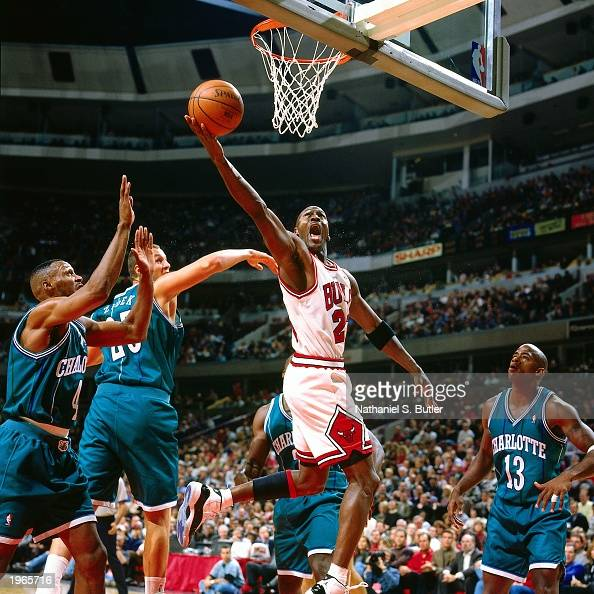 Michael Jordan of the Chicago Bulls drives to the hoop against the Charlotte Hornets during the NBA game at the United Center on November 3 1995 in...