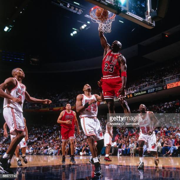 Michael Jordan of the Chicago Bulls dunks against Alonzo Mourning of the Miami Heat in Game Three of the Eastern Conference Finals during the 1997...