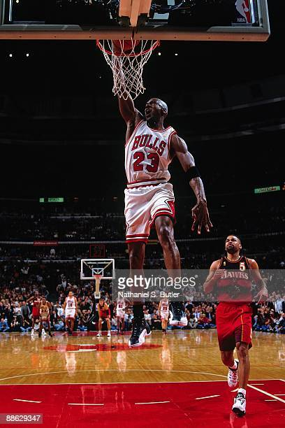 Michael Jordan of the Chicago Bulls dunks against the Atlanta Hawks in Game Five of the Eastern Conference Semifinals during the 1997 NBA Playoffs at...