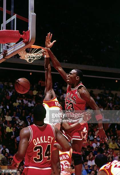 Michael Jordan of the Chicago Bulls dunks against the Atlanta Hawks during a game played in 1986 at the Omni in Atlanta Georgia NOTE TO USER User...