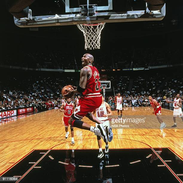 Michael Jordan of the Chicago Bulls dunks against the Miami Heat during a game played in 1996 at Miami Arena in Miami Florida NOTE TO USER User...