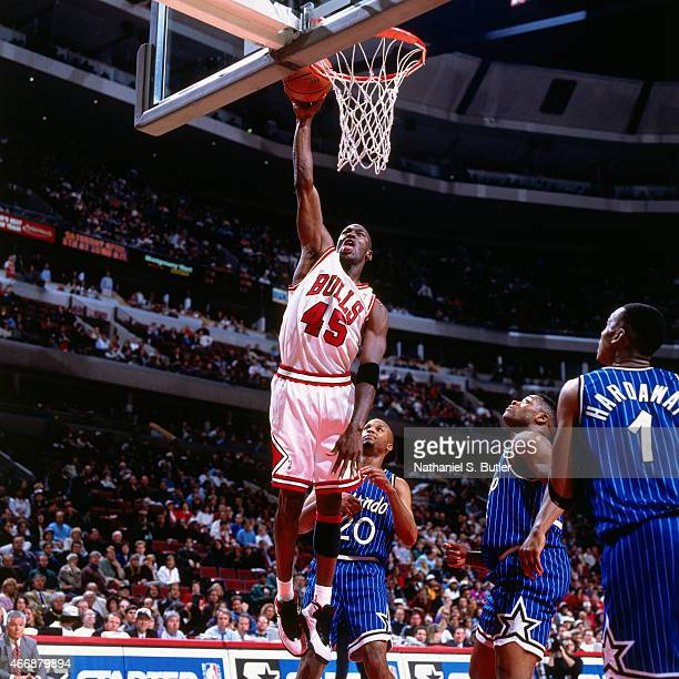 Michael Jordan of the Chicago Bulls dunks against the Orlando Magic on March 24 1995 at United Center in Chicago Illinois This game is Michael...