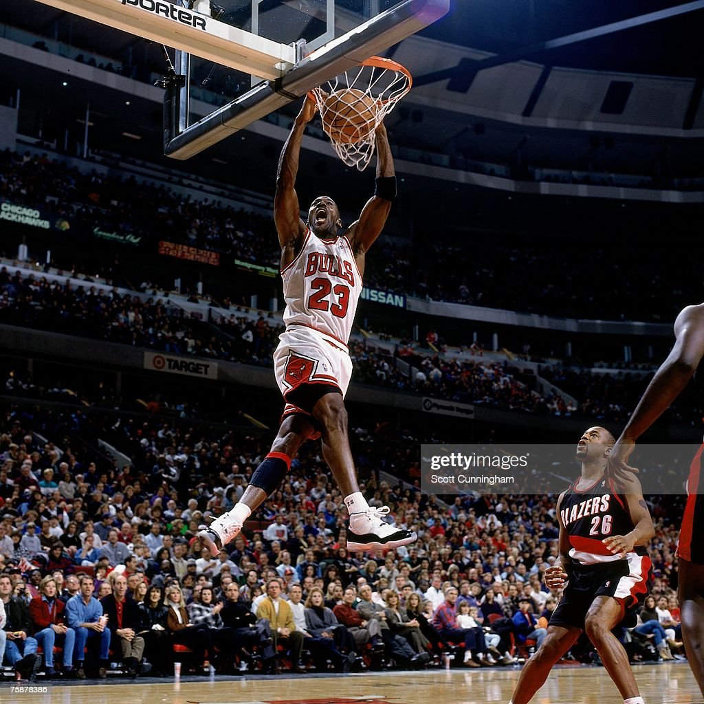 Michael Jordan of the Chicago Bulls dunks against the Portland Trail Blazers during a 1996 NBA game at the United Center in Chicago Illinois NOTE TO...