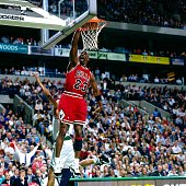 Michael Jordan of the Chicago Bulls dunks the ball against the Boston Celtics during the NBA game at the FleetCenter on December 18 1995 in Boston...