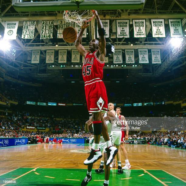 Michael Jordan of the Chicago Bulls dunks the ball against the Boston Celtics during the NBA game at the FleetCenter on March 22 1995 in Boston...
