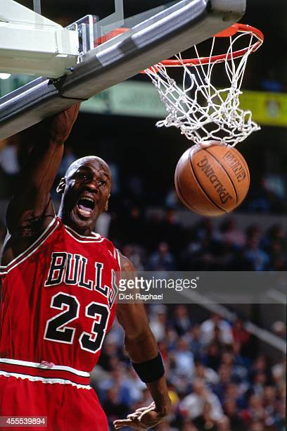 Michael Jordan of the Chicago Bulls dunks the ball against the Boston Celtics during a game circa 1995 at the Boston Garden in Boston Massachusetts...