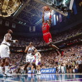 Michael Jordan of the Chicago Bulls dunks the ball against the Utah Jazz during Game three of the 1997 NBA Finals at the Delta Center on June 6 1997...