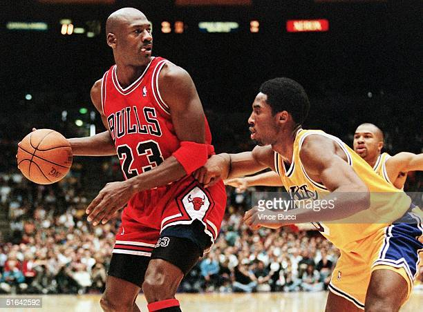 Michael Jordan of the Chicago Bulls eyes the basket as he is guarded by Kobe Bryant of the Los Angeles Lakers during their 01 February game in Los...