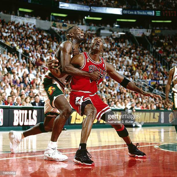 Michael Jordan of the Chicago Bulls fights for a rebound against Shawn Kemp of the Seattle SuperSonics during Game five of the 1996 NBA Finals at Key...