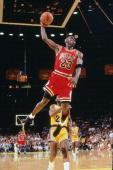 Michael Jordan of the Chicago Bulls goes for a dunk against the Los Angeles Lakers in game five of the 1991 NBA Finals on June 12 1991 at the Great...